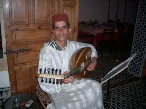 Musician playing traditional music at a restaurant in Rabat