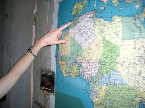 Africa map with finger pointing at Morocco